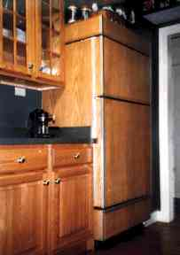 Sun Frost refigerator with a wood veneer finish to match other kitchen cabinets.