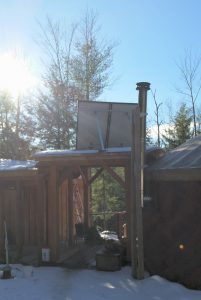 Back of Canadian Solar panels on the treehouse.