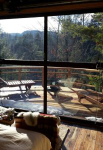 View out of the hangar windows and deck of the Maine solar powered treehouse.