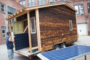 Loading up solar panels for installation on Tiny House On Wheels