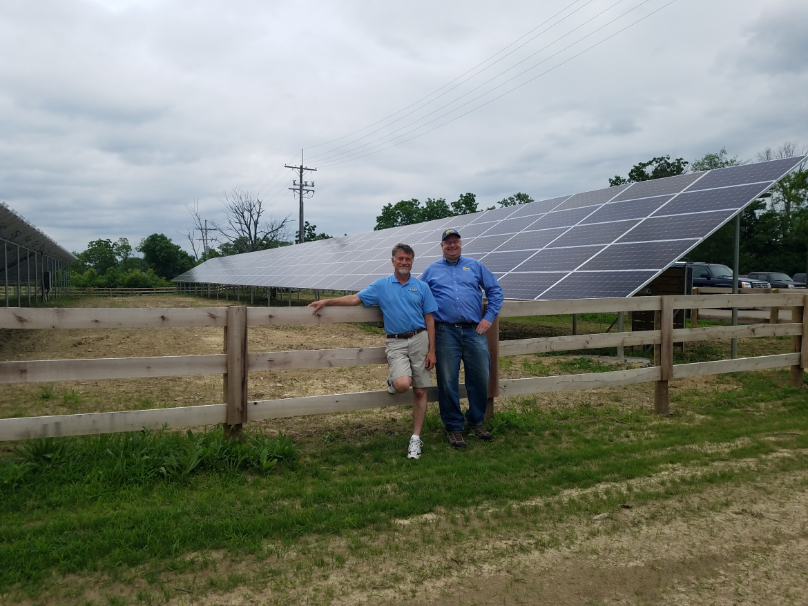 altE Technical Sales Representative Adam Dischino (Right) with Jim Yockey, CEO of Rocknoll Energy, in front of the newly completed Armco Park Solar Array and Pollinator Habitat.