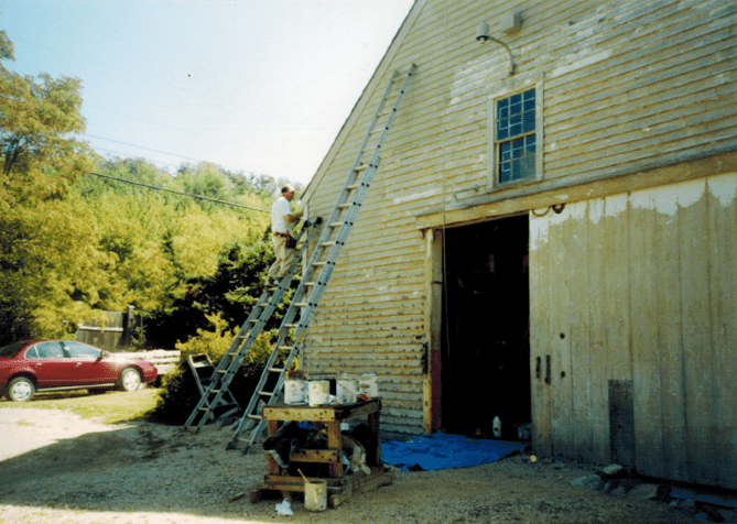 Wayne Deri works on the barn in Downeast Maine.