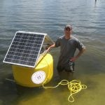 AltE customer prepares a buoy for deployment to the Arctic