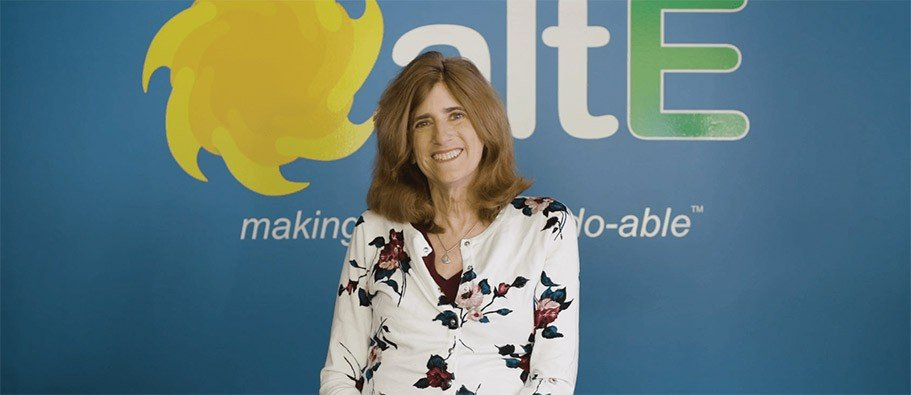 Amy Beaudet, the Solar Queen, in front of the altE logo