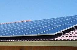 solar panels mounted flush to a Spanish tile roof