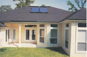 a home with a small solar thermal system on its roof