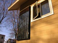 solar water heater installed on the outside of a brown house
