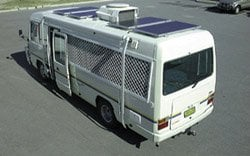 an RV with solar panels on the roof