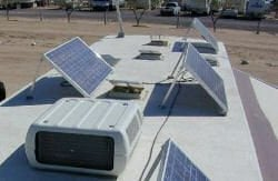 solar panels mounted at an angle on the roof of an RV