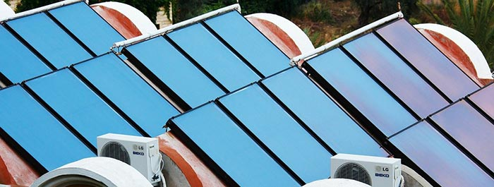 a building roof with solar water collectors installed on it