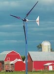 Whisper wind turbine on a farm